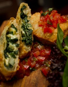 Cornish goats' cheese and spinach filo pastry parcels served with English heritage plum tomato concase and herb salad at Putney Pies
