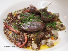 Pan roasted, quick smoked pigeon breasts with creamy lentils, broad beans, sage and bacon at River Cottage Axminster