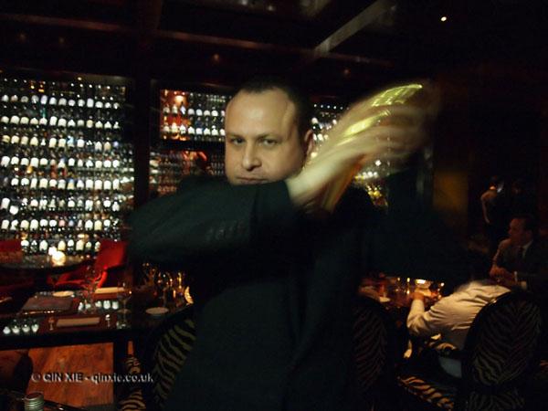 Davide Guidi shaking cocktails at Amaranto Bar, Four Seasons London