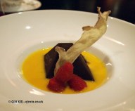 Chocolate caramel meringue with ginger sauce at Dego, London