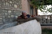 Man by grape crusher at Pheasant's Tears vineyard in Georgia