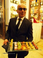 Waiter with canapés, Laurent Perrier Tous Les Sense at Massimo, The Corinthia, London