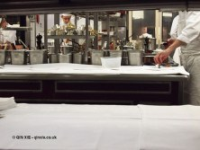 Kitchen through hot pass, 25th Anniversary Celebration Menu at Alain Ducasse's Le Louis XV in Monte Carlo, Monaco