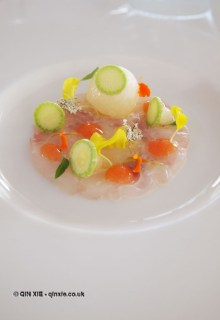 Sea bream carpaccio, melon balls, basil oil, flowers, citrus gel, courgette, Mirazur, Menton