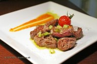 Sirloin from specially reared cattle, served in chunks with green garlic shoots, Casa Montaña, Valencia