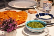 Farinata (chickpea pie) with stracchino cheese and Genovese pesto sauce, Portivene, Portovenere