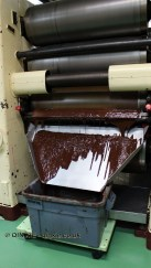 Chocolate paste through the refiner, Diamond Chocolate Factory