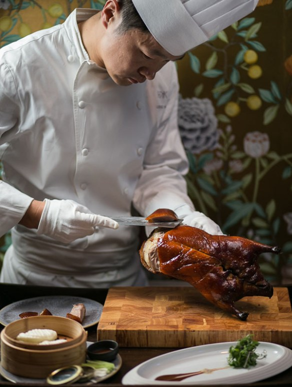 Chef carving cherry wood duck at HKK