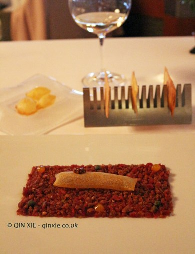 Very thin and light beef tartar, new potato soufflé and aromatic herb bread at Pedro Subijana Akelarre, San Sebastian