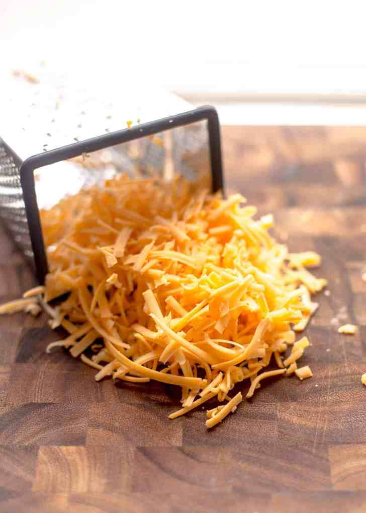 Grated Cheese for Savory Waffles with Sausage and Cheddar
