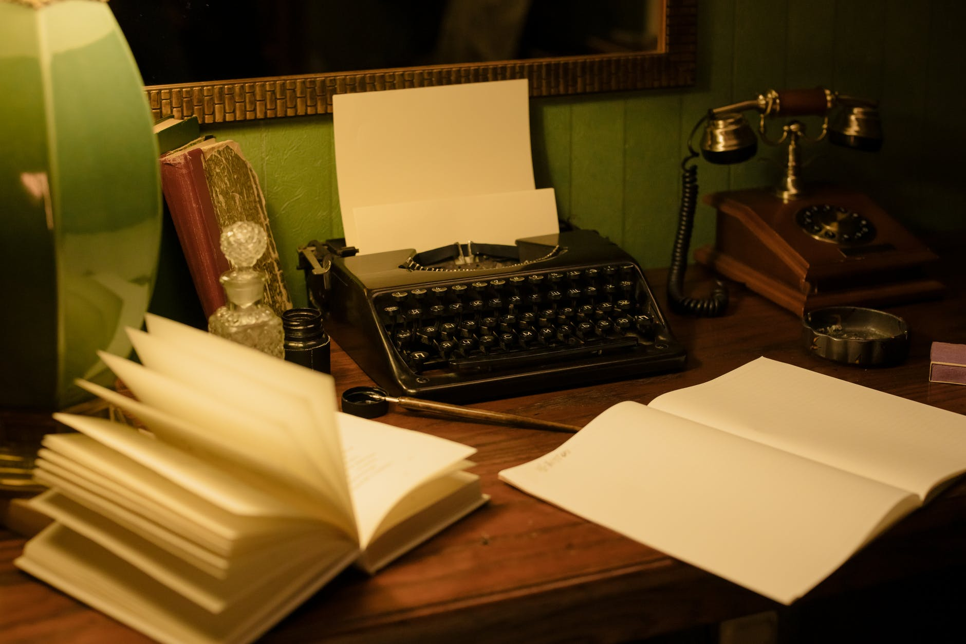 vintage typewriter and telephone on the table