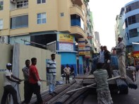 2. Bangladeshi construction workers unloading materials from a lorry in Majeedhi Magu of Male'. Since the year 2000, construction industry has progressed significantly in Maldives while the majority of employees in the industry are Bangladeshi nationals.