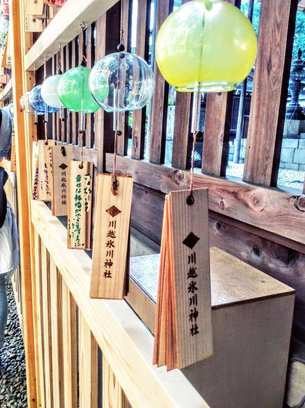 "The ""ema"" (wooden plaques for writing prayers) of Hikawa shrine wind chimes"