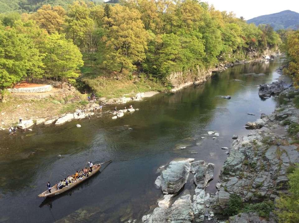 Nagatoro Line Kudari boat ride down theArakwa river passing Nagatoro Autocamp with children playing in the river