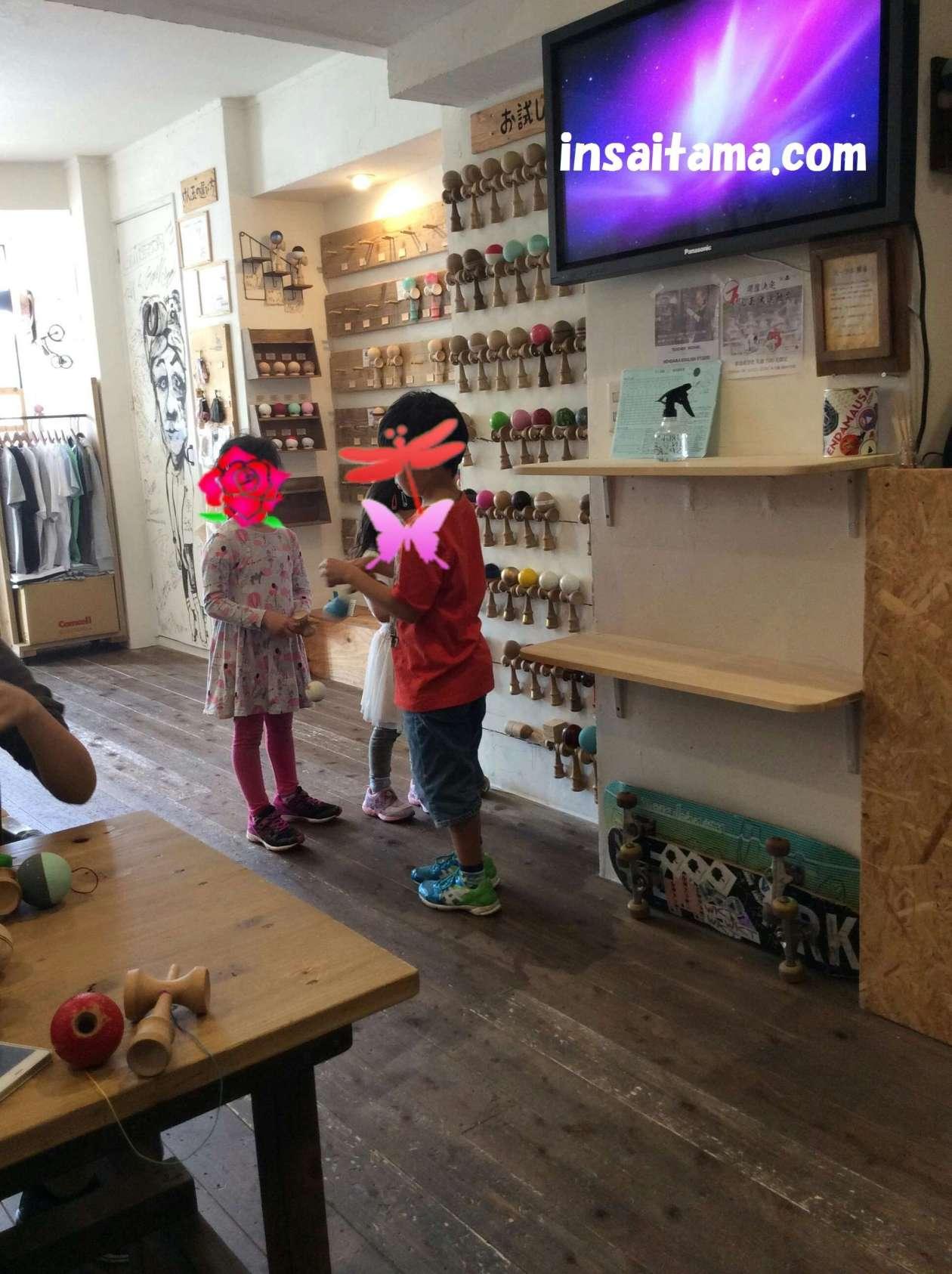 Su Lab Kendama lined up, Kids playing with kendama in Kawagoe Japan