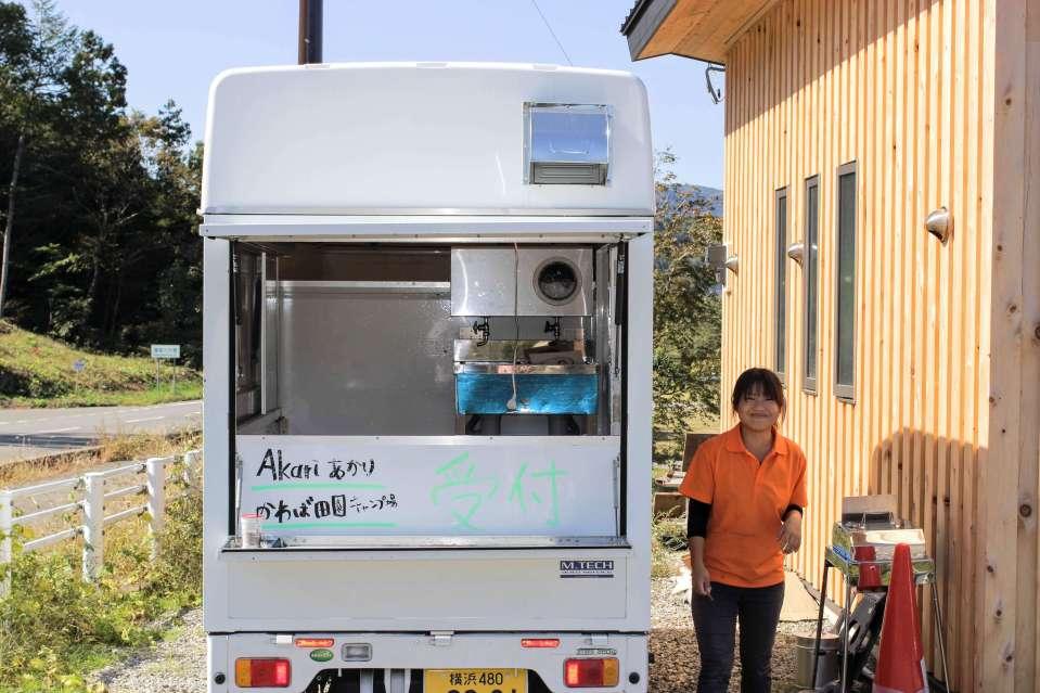 Check in at a van at Akari Campsite