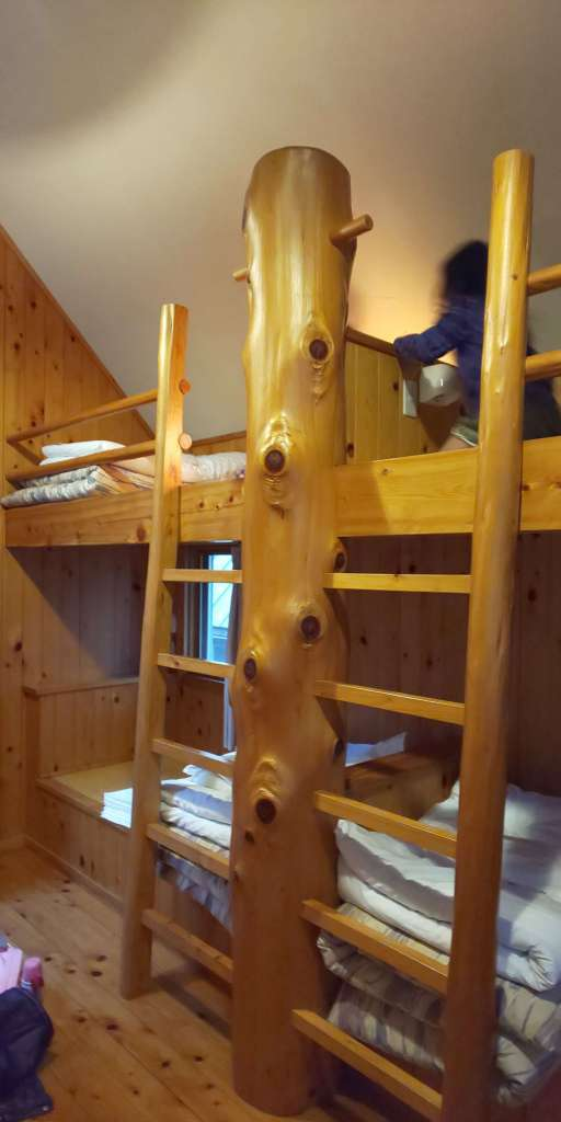 Picture of bunk beds in the two storey log cabins of Yoshida Genki mura