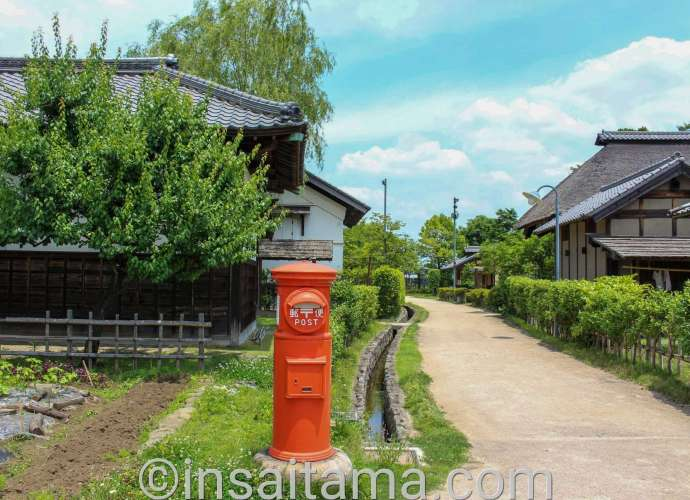 Old post box and timeslip buildings at Nanbata Castle park