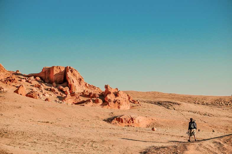 person conquering challenges in a desert
