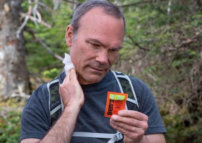 Hiker applying Ben's Wipe