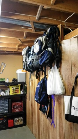 Backpack storage in laundry room.