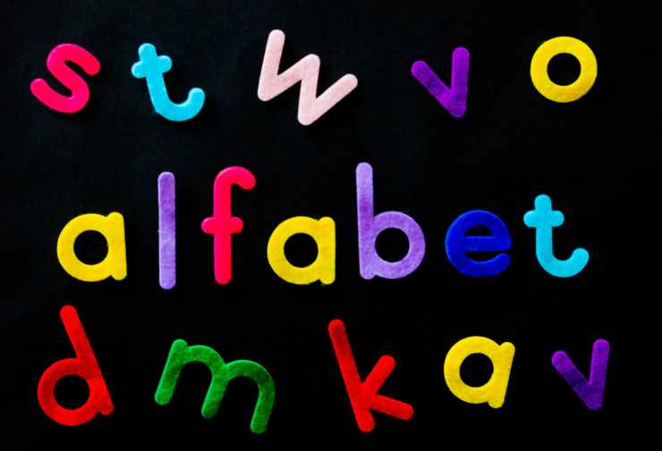 assorted color alfabet letters on black background