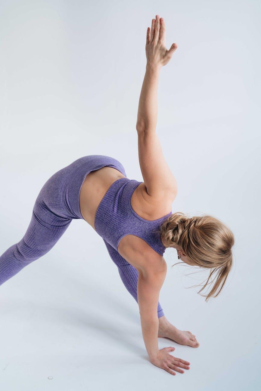 a woman doing a triangle pose