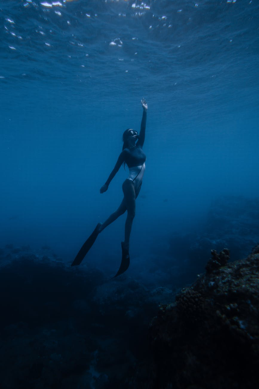 person swimming in the ocean