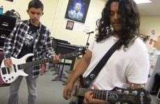 Students in summer school, playing guitars.