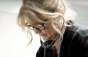 School nurse with stethoscope.