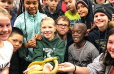 Group of students at Sly Park holding a yellow snake.