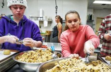 Two students with autism making cookies.