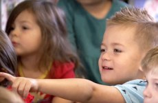 Preschool student pointing with finger.