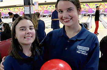 Two students in bowling class.