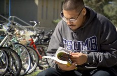 foster youth program student sitting at california state university, monterey bay, reading a textbook