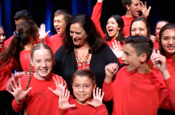 melanee wyatt with yes company theater students on stage