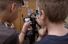 Two media students from Oak Hill Elementary School filming fellow classmates.