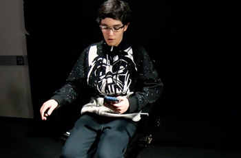 Student sitting in director's chair