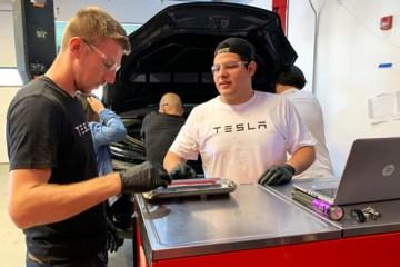 Tesla START students working on vehicle