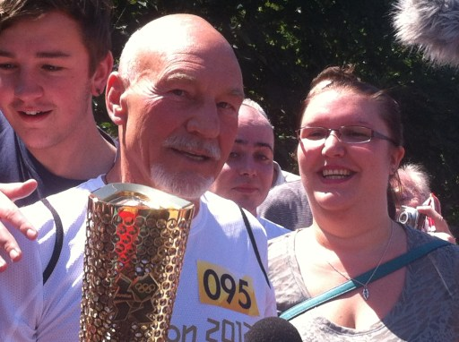 Sir Patrick Stewart, with the Olympic Torch, on one of the days when the sun shone on Croydon this year