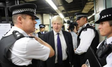 London Mayor Boris Johnson with police: but probably not in a police station in Croydon