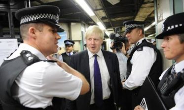 London Mayor Boris Johnson with police: but probably not in a police station