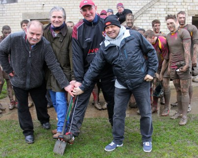 Breaking up: With muddied players watching on, Rob Hardy, Steve O'Connell (second left), Dick Towers and Brian Dickens get Streatham and Croydon's redevelopment work underway at Frant Road