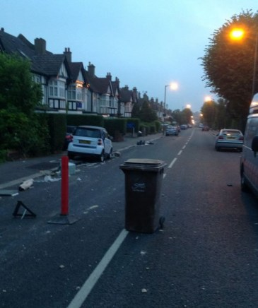 The scene on Mayfiield Road yesterday morning, when some of the clearance work had already been done by residents