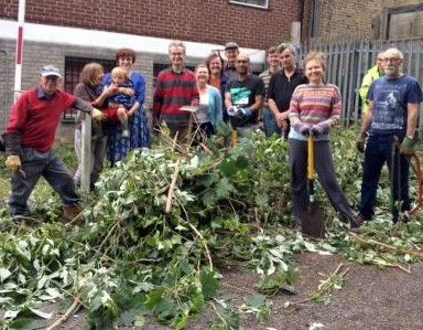 Robert Gibson and the team of library volunteers after clearing the garden area earlier in the summer. They need your help to progress the work this Saturday