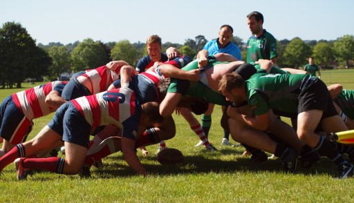 No push-overs: Old Mid-Whitgiftians, in green, got a solid work-out in the sun at Dorking last weekend. Picture by Gerald Murphy