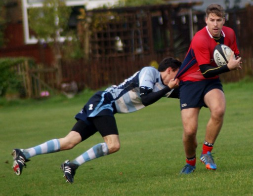 Hard to grasp: Adam Downey-Keene tries to get a grip of an Aylesford player in Saturday's defeat at Hamsey Green