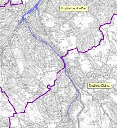 The course of the Caterham Bourne, which for much of the time has the appearance of a dry ditch. But now it is in full spate, with flood warnings around Kenley