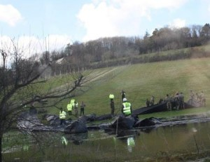 With the ground saturated from the heavy winter rains, soldiers and engineers construct a temporary dam on the downs at Woldingham to back-up some of the water on the Caterham Bourne