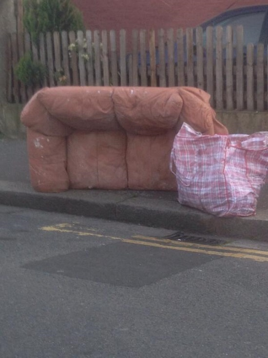 A dumped old sofa and assorted crap, photographed in Ashburton on Apr 13